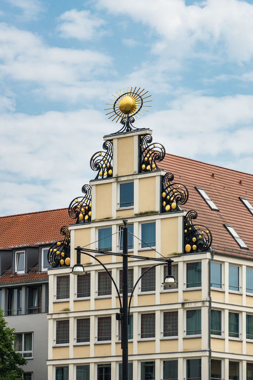 Building in Rostock, Germany. City Holiday Mecklenburg-Vorpommern Rostock Sky And Clouds Architecture Building Building Exterior Built Structure Cloud - Sky Journey Landmark Neuer Markt No People Outdoors Tourism Town Travel Destinations Vacation Yellow