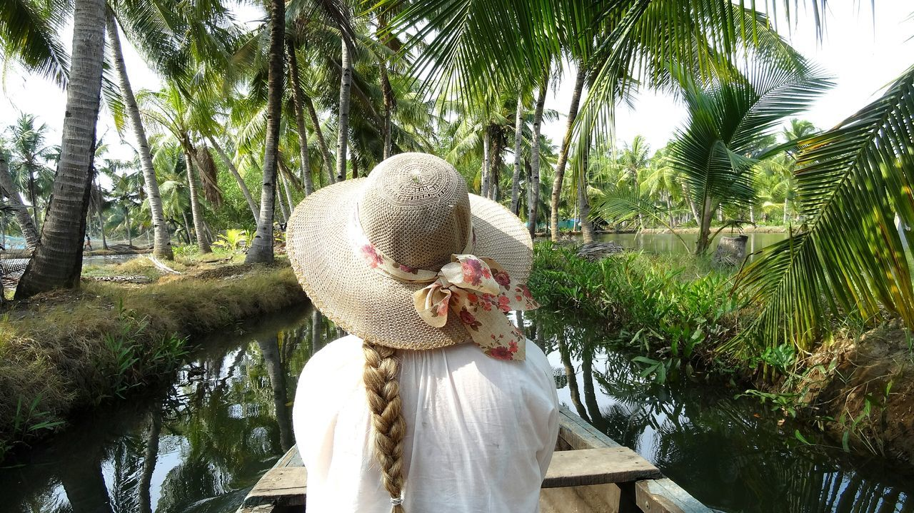 My Year My View Tree One Person Nature Outdoors Day People Indiapictures Incredible India Backpacking Tranquil Scene Palm Trees Channel View River Jungle Canoo Boat Person From The Back Braided Hair Womanwithhat Green Color Hat Travel Photography