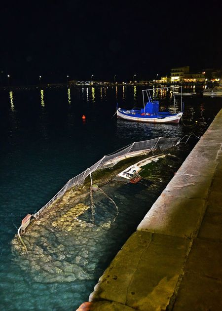 Sunken boat Boat Night No People Outdoors Rippled Showing Imperfection Sunken Sunken Boat Telling Stories Differently Up Close Street Photography Water Water Reflections Cities At Night