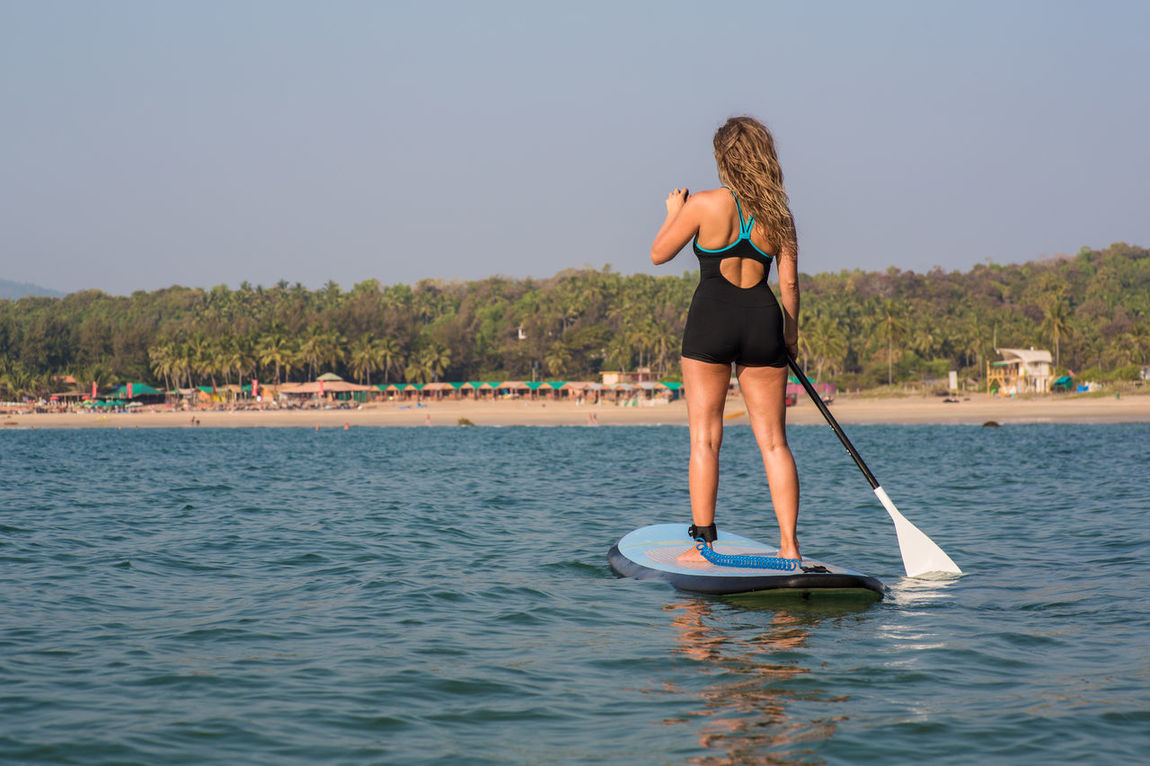 Girl doing stand up paddling at a beach in Goa Beach Beauty In Nature Clear Sky Day India Leisure Activity Lifestyles Nature One Person Outdoors Real People Sea Stand Up Stand Up Paddle #SUP Stand Up Paddle SUP Stand Up Paddling Standing Sup Travel Destinations Water Waterfront Young Women