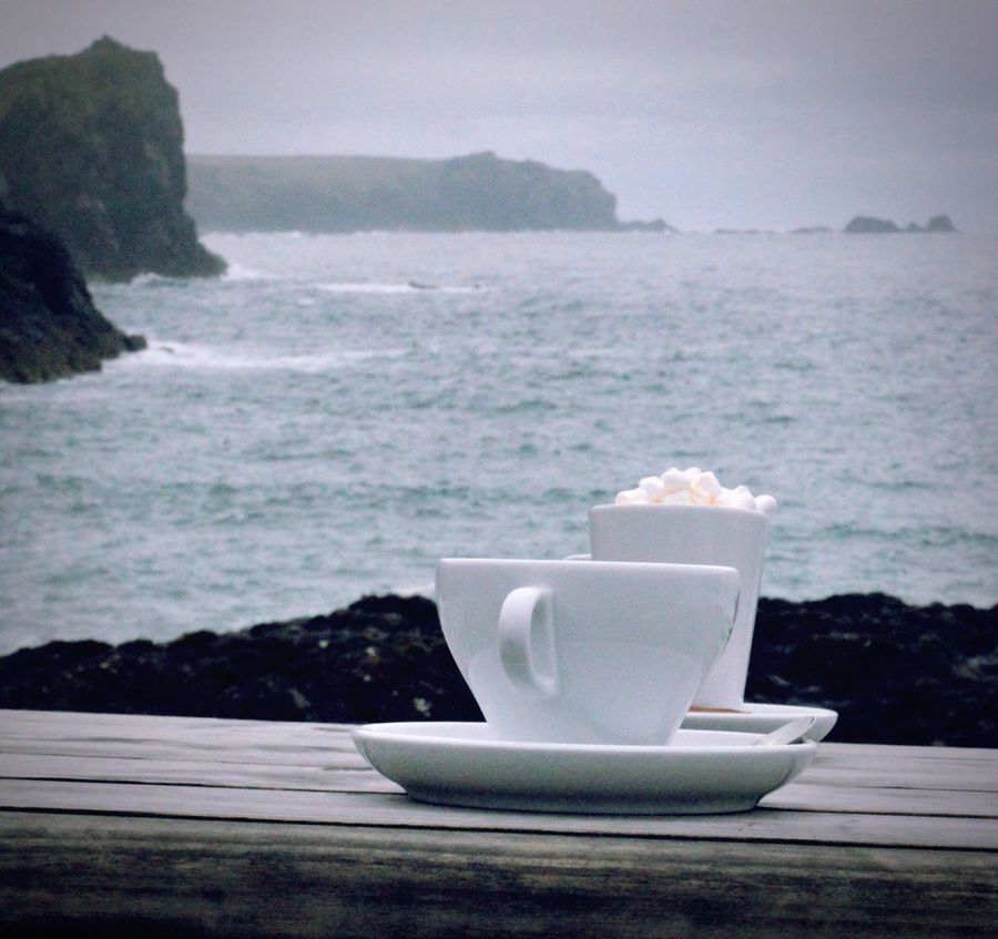 Cold weather = hot chocolate Coffee - Drink Drink Sea Table Refreshment Saucer Food And Drink No People Horizon Over Water Hotel Chocolate Marshmallows Water Freshness Close-up Nature Outdoors Food Sky