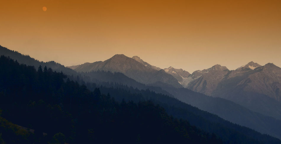 Natural Gradient Beauty In Nature Calm Idyllic Landscape Majestic Moon Mountain Mountain Range Natural Gradient Nature Eyeem Collection Non Urban Scene Orange Color Outdoors Physical Geography Remote Scenics Sky Snowcapped Mountain Sunset Tourism Tranquil Scene Tranquility Travel Destinations Weather