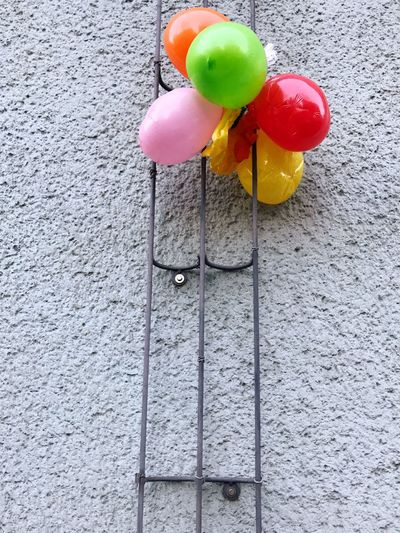 Wall - Building Feature Decoration Multi Colored Balloon No People Pink Color Architecture Helium Balloon