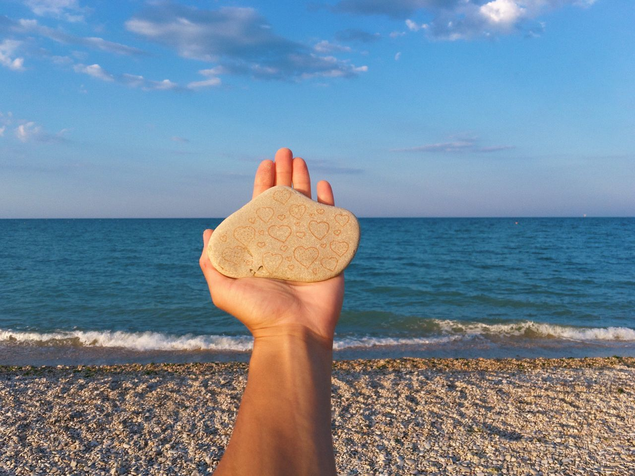 Sea love ❤️... Sea Human Hand Human Body Part Real People Horizon Over Water Water One Person Personal Perspective Beach Sky Human Finger Lifestyles Leisure Activity Outdoors Nature Day Beauty In Nature Cloud - Sky Sand Close-up Love Summer Stone Art Stone Holding