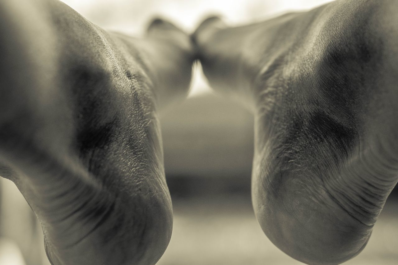 Real People Lifestyles Close-up Two People Human Hand Human Body Part Leisure Activity Sand Women Indoors  Human Skin Fragility Togetherness Only Women Day Adult People Adults Only Feet Blackandwhite