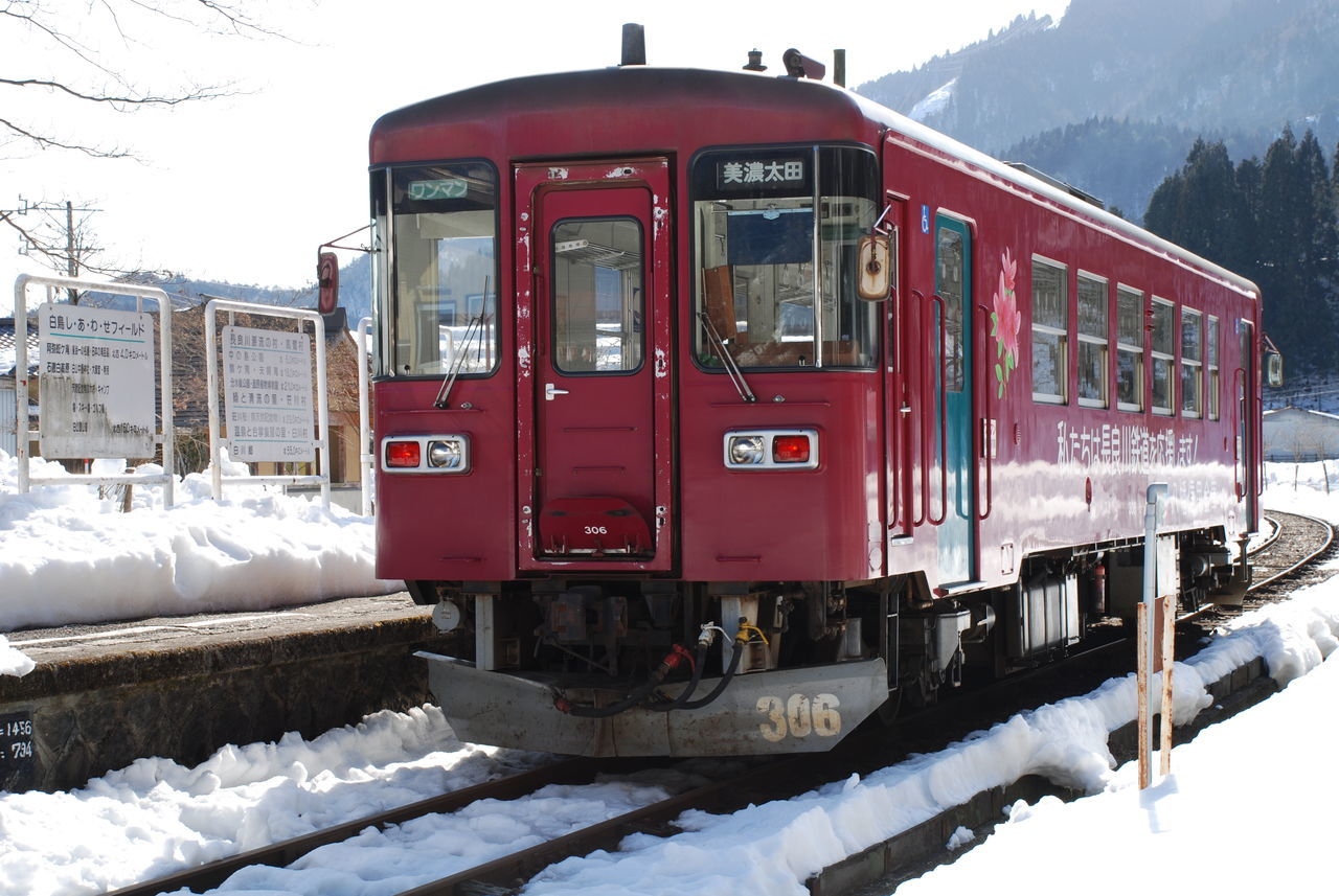 winter, cold temperature, snow, weather, transportation, rail transportation, train - vehicle, frozen, nature, mode of transport, day, outdoors, railroad track, public transportation, snowcapped mountain, red, mountain, beauty in nature, tree, no people, sky