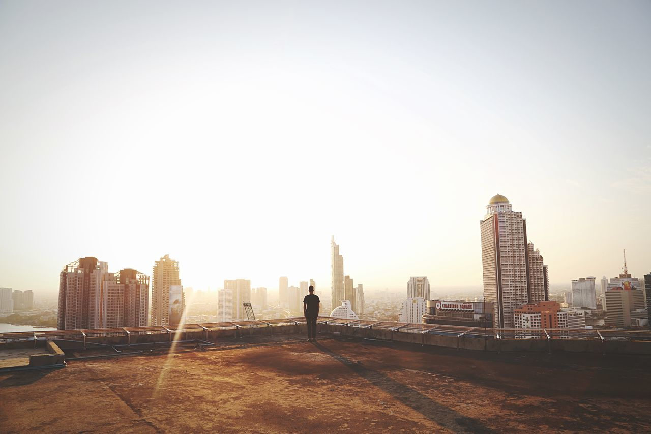 Man Looking At City View Against Sky