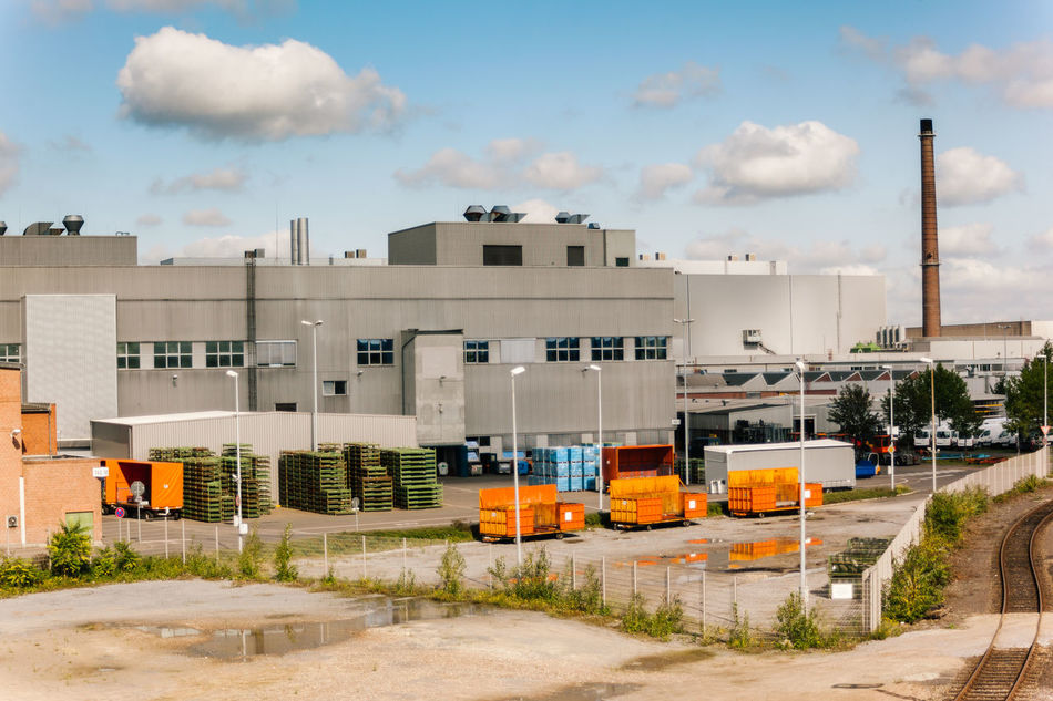 Industrial view Blue Sky Building Exterior Built Structure Composition Container Crates Day Dirt Dry Factory Grey Industrial Industry Landscape Metal No People Orange Pallets Platoon Puffy Clouds Smoke Storage Tower Tracks Train