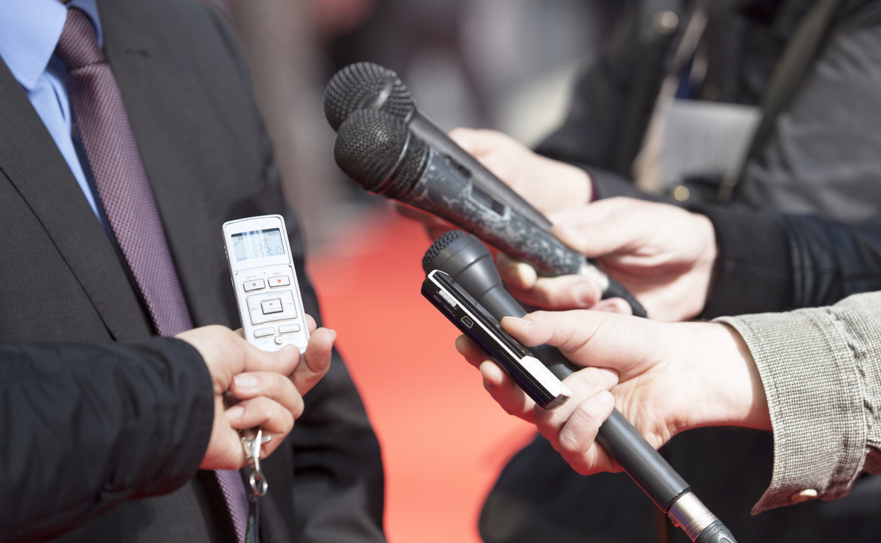 Reporters making interview with businessman or politician Adult Broadcasting Business Finance And Industry Businessman Close-up Conference Event Holding Indoors  Interview Day  Journalist Men Microphone Occupation People Politician Press Radio Reportage Telephone