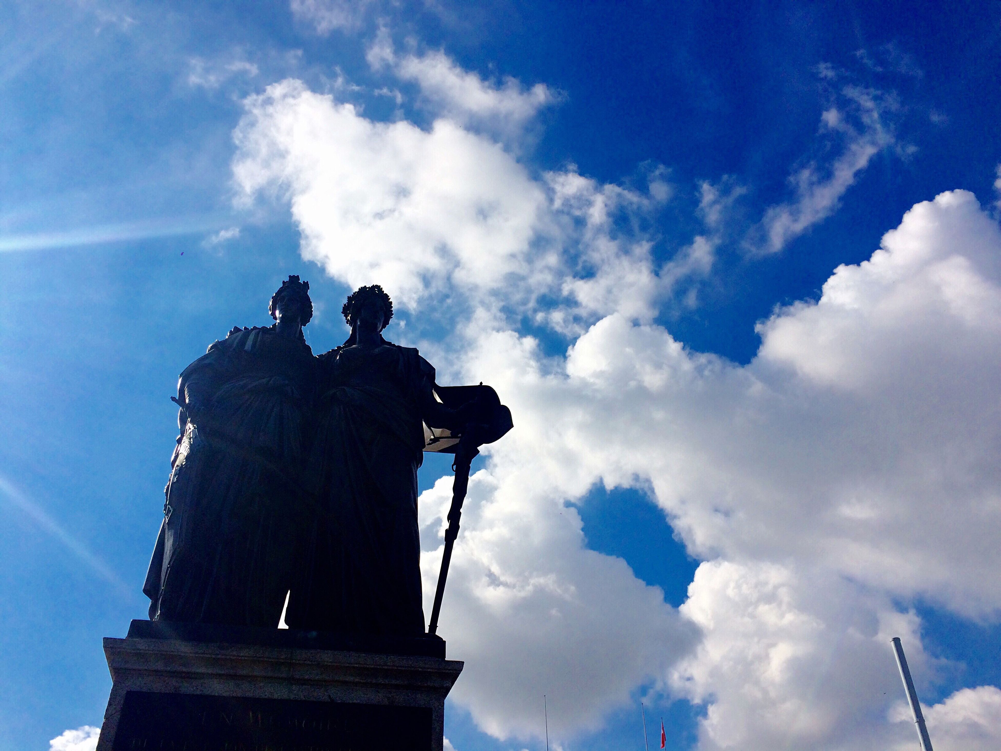 cloud - sky, low angle view, sky, two people, outdoors, only men, people, men, day, statue, adults only, adult, human body part