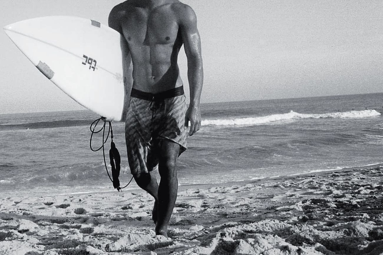 Surfer boy OpenEdit Surfer Body & Fitness The Amazing Human Body The Action Photographer - 2015 EyeEm Awards The Portraitist - 2015 EyeEm Awards The Action Photographer - 2015 EyEm Awards Blackandwhite Life Is A Beach Black And White Surf's Up