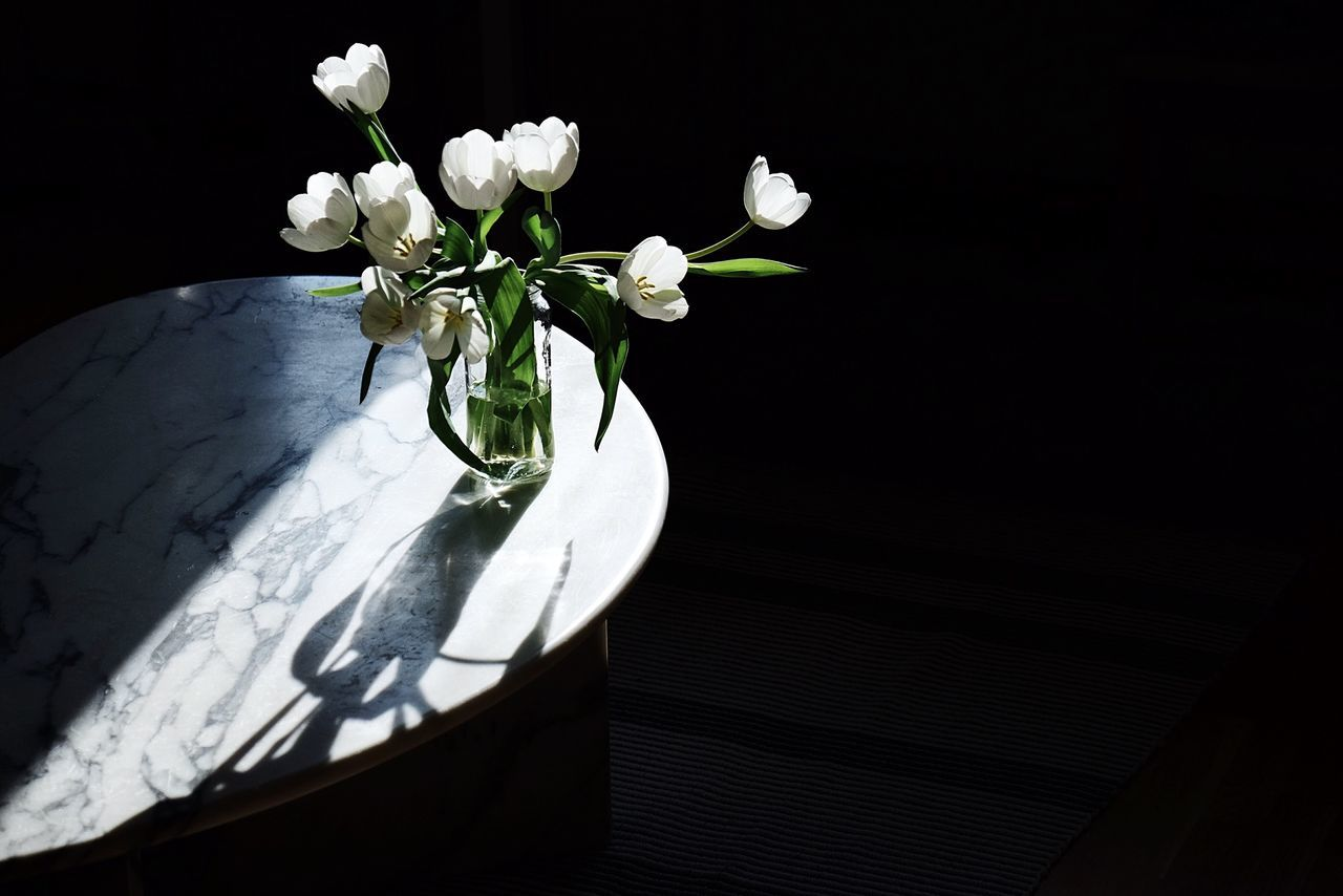 High Angle View Of Flower Vase On Table