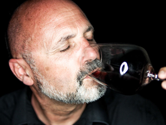 Alcohol Beard Black Background Close-up Drink Drinking Focus On Foreground Food And Drink Freshness Headshot Indoors  Leisure Activity Mature Adult Mature Men Men One Person Quality Real People Studio Shot Testing Wine Wine Moments Wine Tasting Wine Testing Wineglass