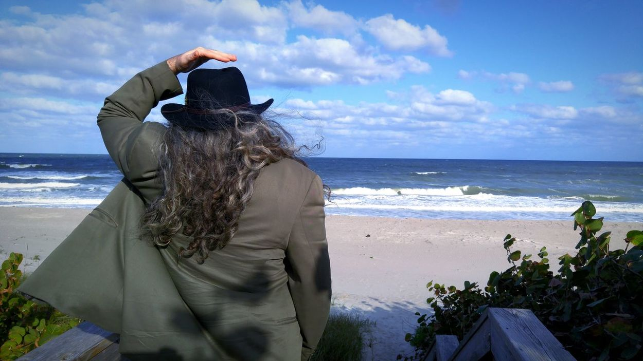 Melbourne Beach Florida USA Road Trip Adventure Buddies Color Portrait Portrait Of A Man  Hat Long Hair Curly Hair Skyporn Sky_collection Sky And Clouds Clouds And Sky From My Point Of View From Where I Stand Behind The Tourist Windy Capture The Moment Life Is A Beach Portrait Of Man The Great Outdoors With Adobe Let Your Hair Down