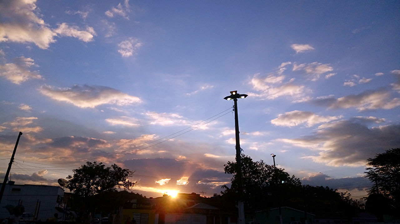 silhouette, sunset, sky, cloud - sky, low angle view, tree, outdoors, street light, no people, built structure, nature, architecture, day