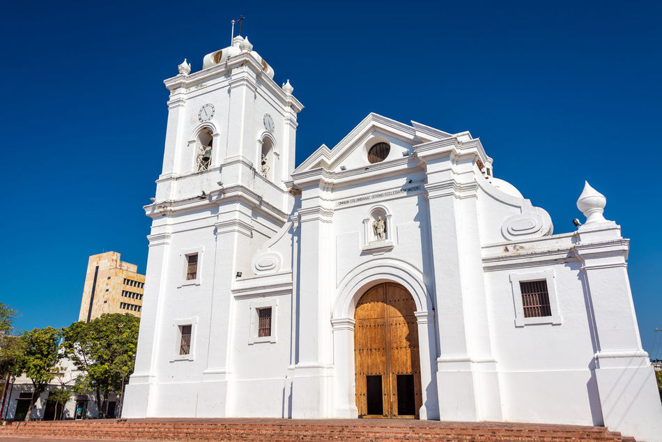 White cathedral of Santa Marta, Colombia with a beautiful deep blue sky America American Architecture City Cityscape Colombia Colonial Day Downtown Façade Heritage Historic Historical Latin Magdalena Old Outdoors Religion Santamarta South Street Town Urban View White