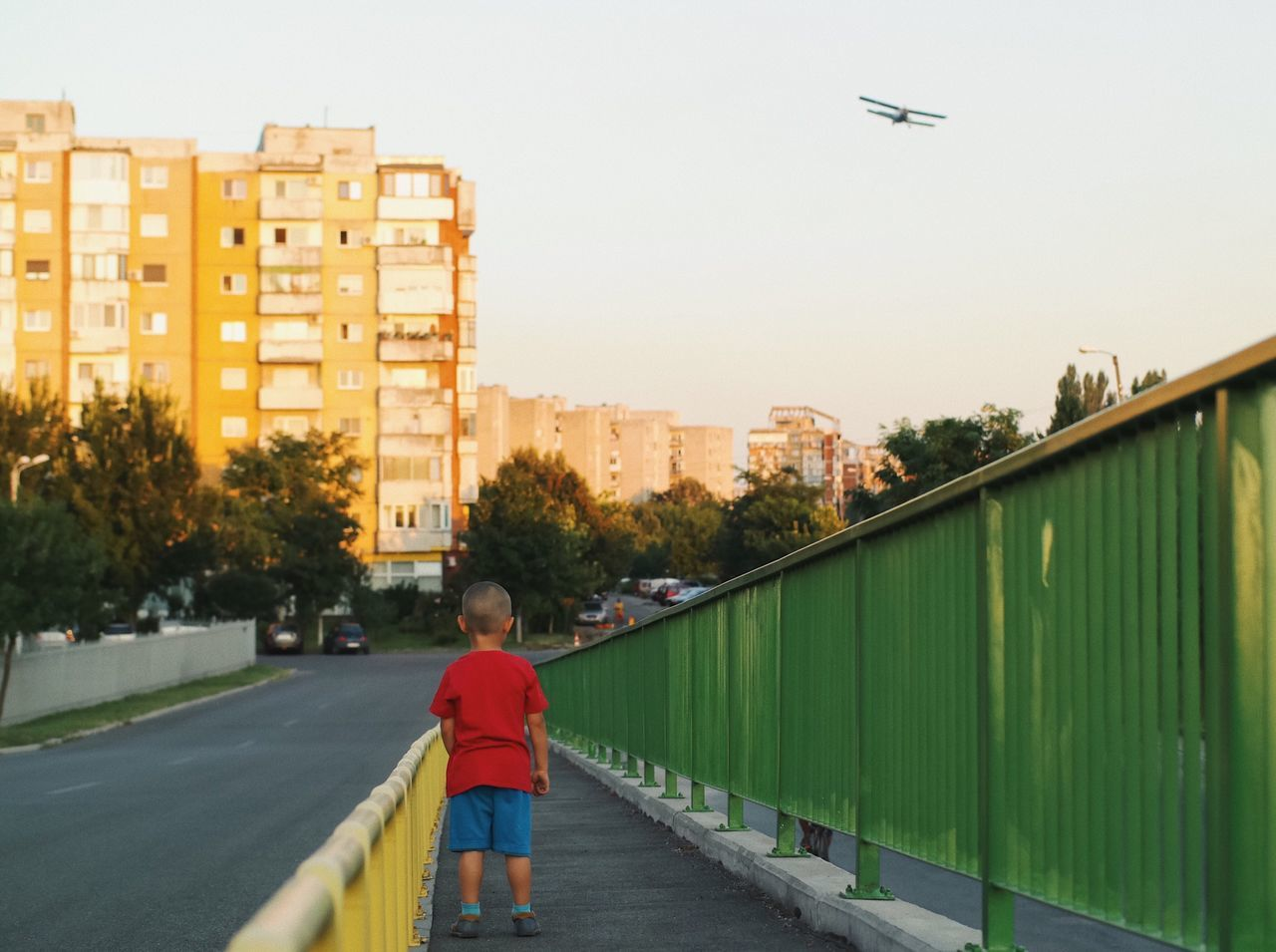 Urban attraction... Plane Architecture Childhood Building Exterior City Flying Urban Child Summer City Life Cityscape People Street Fashion Details Of My Life Lifestyles Having Fun VSCO Travel Casual Clothing Standing Leisure Activity Made In Romania Outdoors Kid Stationary The Architect - 2017 EyeEm Awards The Street Photographer - 2017 EyeEm Awards