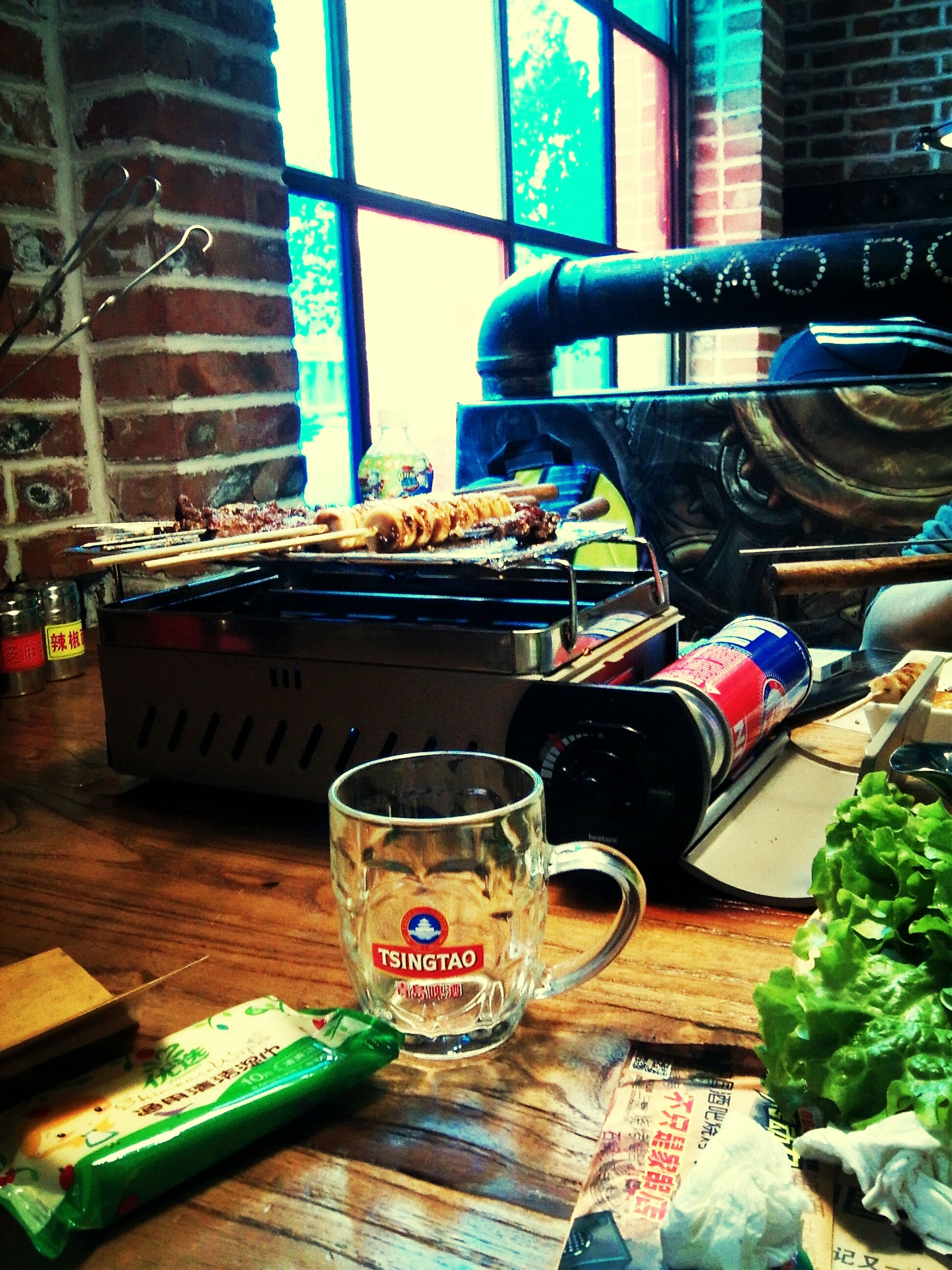 table, drink, food and drink, still life, indoors, refreshment, no people, blue, day, bottle, close-up, wood - material, freshness, chair, drinking glass, focus on foreground, high angle view, container, sunlight, metal