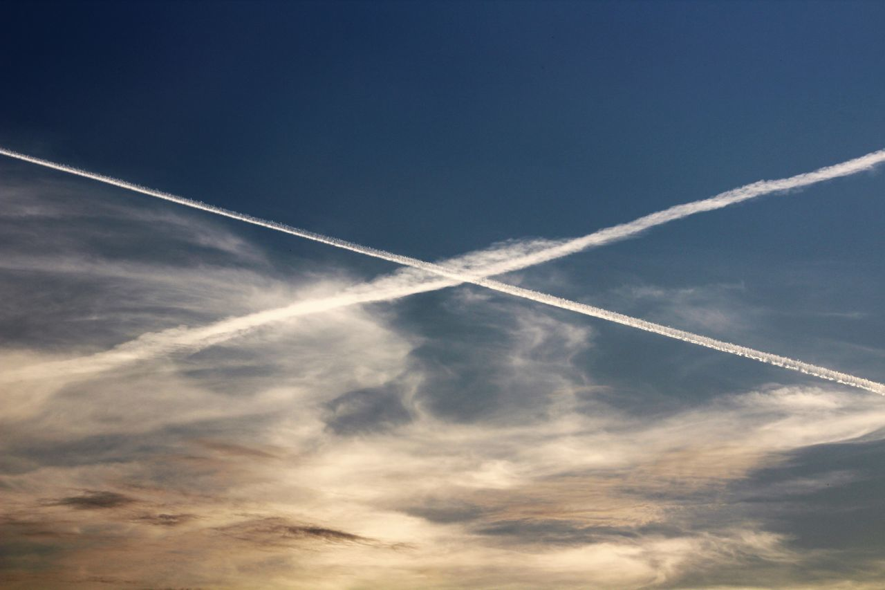 vapor trail, contrail, low angle view, white, nature, blue, sky, no people, outdoors, beauty in nature, scenics, day