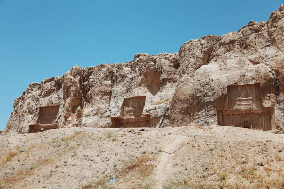 Miles Away Tomb Of Dariush King History Shīrāz Iran Tomb Of Darius Clear Sky Architecture Building Exterior Built Structure Sunlight No People Day Low Angle View Outdoors House Landscape Arid Climate Nature Ancient Civilization (null)Open Edit Naqsh-e Rostam Achaemenid Empire