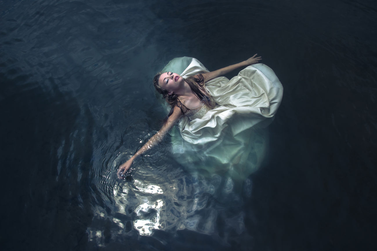 """This photoshoot took place in a lake in Upstate New York. The images tell the story of a runaway bride. I called this photoshoot """"Survivor Bride"""". It has been published in several international publications. Beauty Beauty In Nature Eyes Fashion Photography Mermaid Model Model Photography Nature Night Water"""