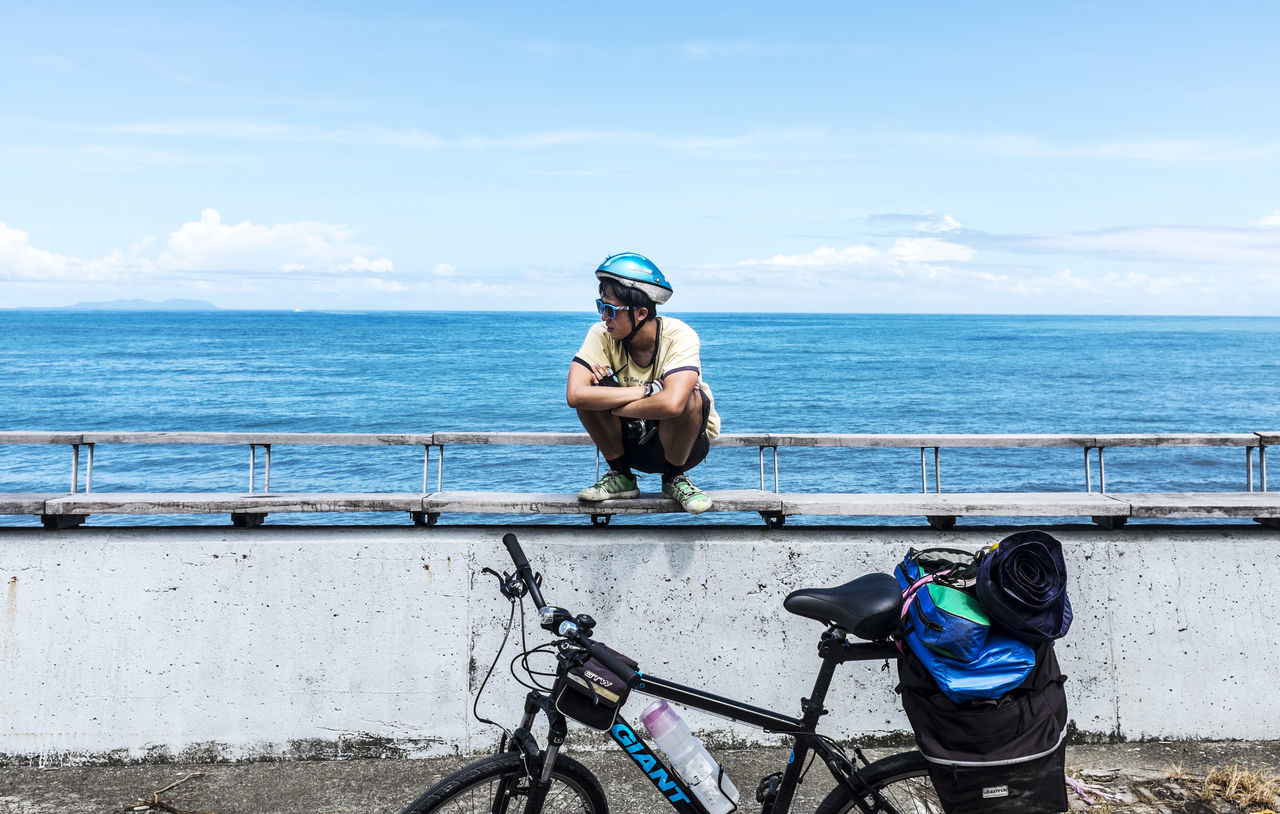 Beautiful stock photos of relax, Arms Crossed, Bench, Bicycle, Chinese Ethnicity