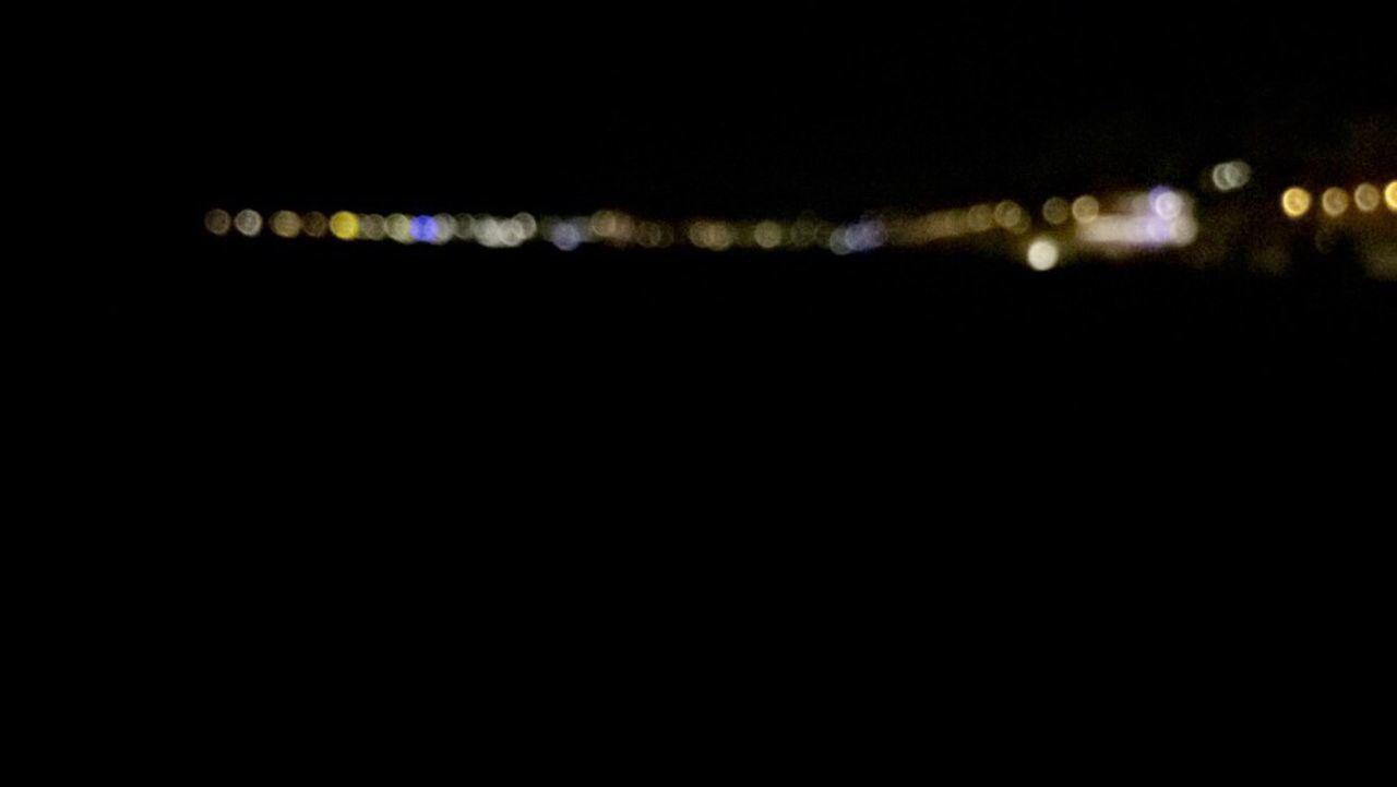 illuminated, night, no people, defocused, close-up, black background, outdoors