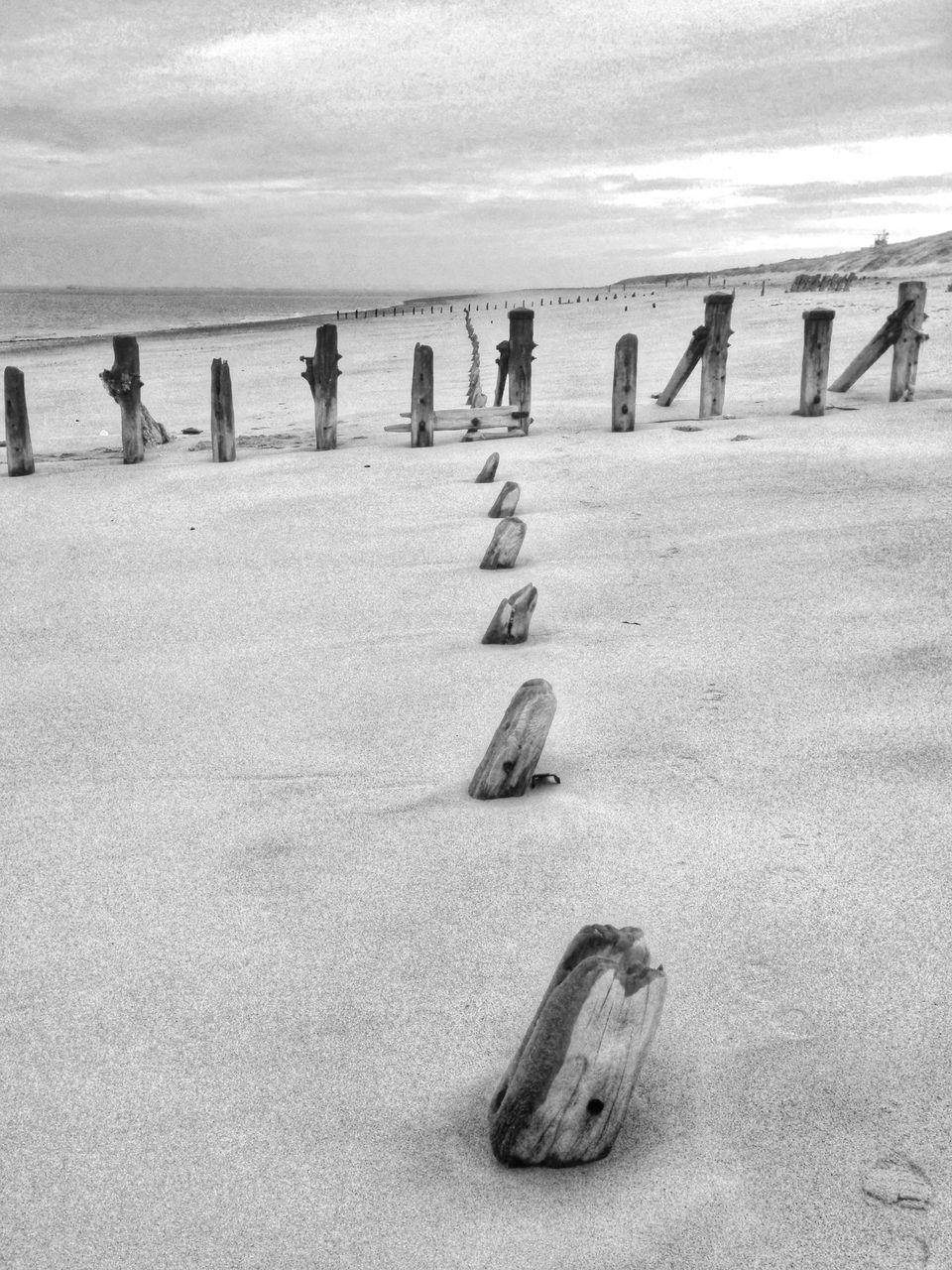 Poles On Beach