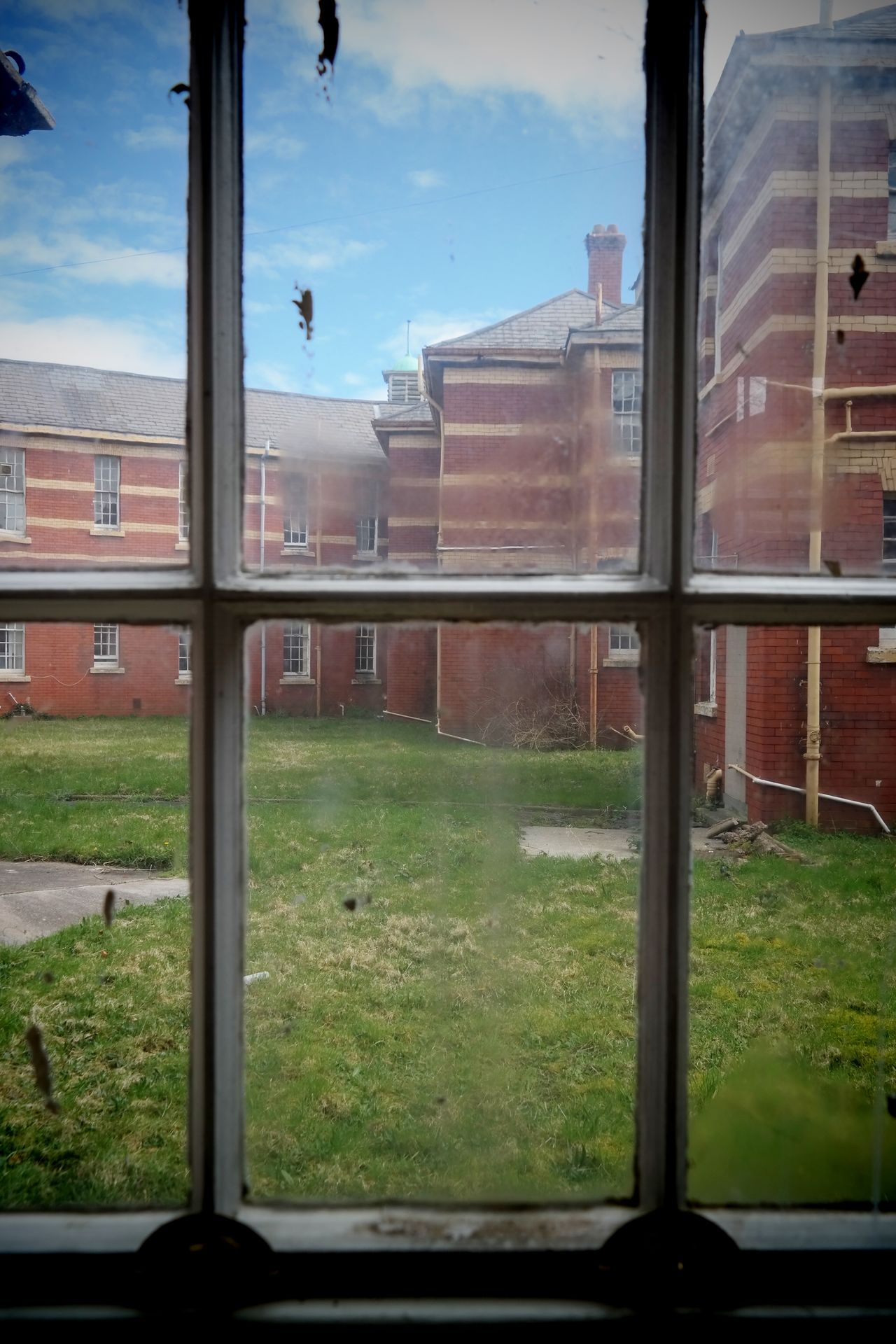 Through the window Architecture Dirty Window Exhibition Grass Hospital No People Outdoors Sky Whitchurch Hospital Window