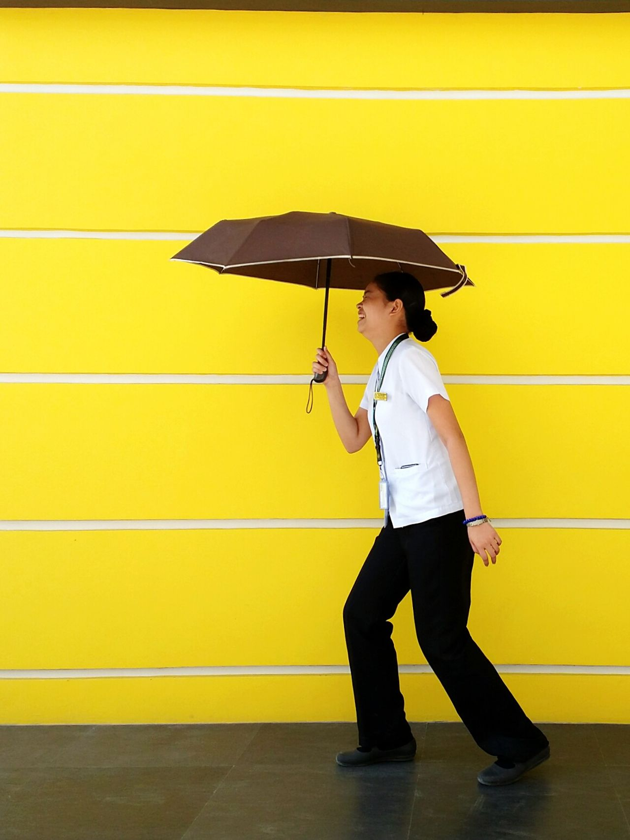 """Because i'm happy!"" -Pharell Philippines Architecture EyeEm EyeEm Best Shots Eyeem Philippines Light And Shadow Filipina Standing Lights And Shadows Person Student Nurse Yellow Umbrella Uniform Samsung Galaxy Camera"