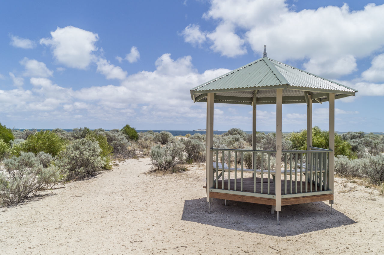 Shelter Beach Blue Sky Blue Sky And Clouds Bushes Clouds Dry House Loneliness Lonely Peaceful Roof Sand Shadow Shelter Sun Wood