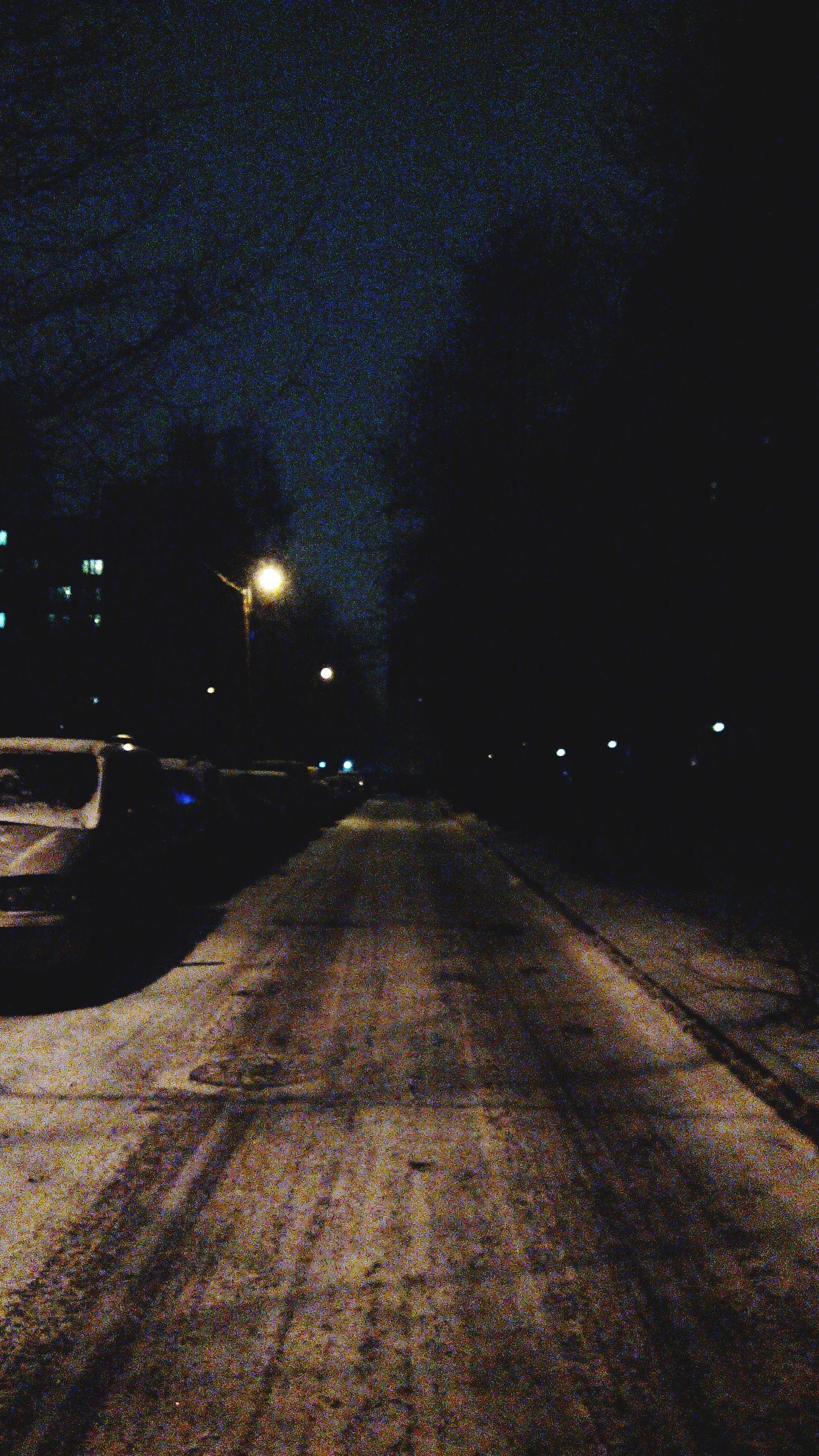 night, the way forward, illuminated, road, street, transportation, diminishing perspective, vanishing point, street light, dark, empty road, sky, long, outdoors, empty, no people, lighting equipment, asphalt, surface level, tranquility