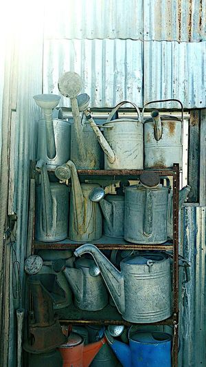 Something a bit different, collection of watering cans at a friend's house. Wateringcan Collection Organization Waterer Collect Collectibles Collector Watering Cans Plant Life Old Antique Vintage Blue Can Cans Tin Tin Cans Rust Rusty