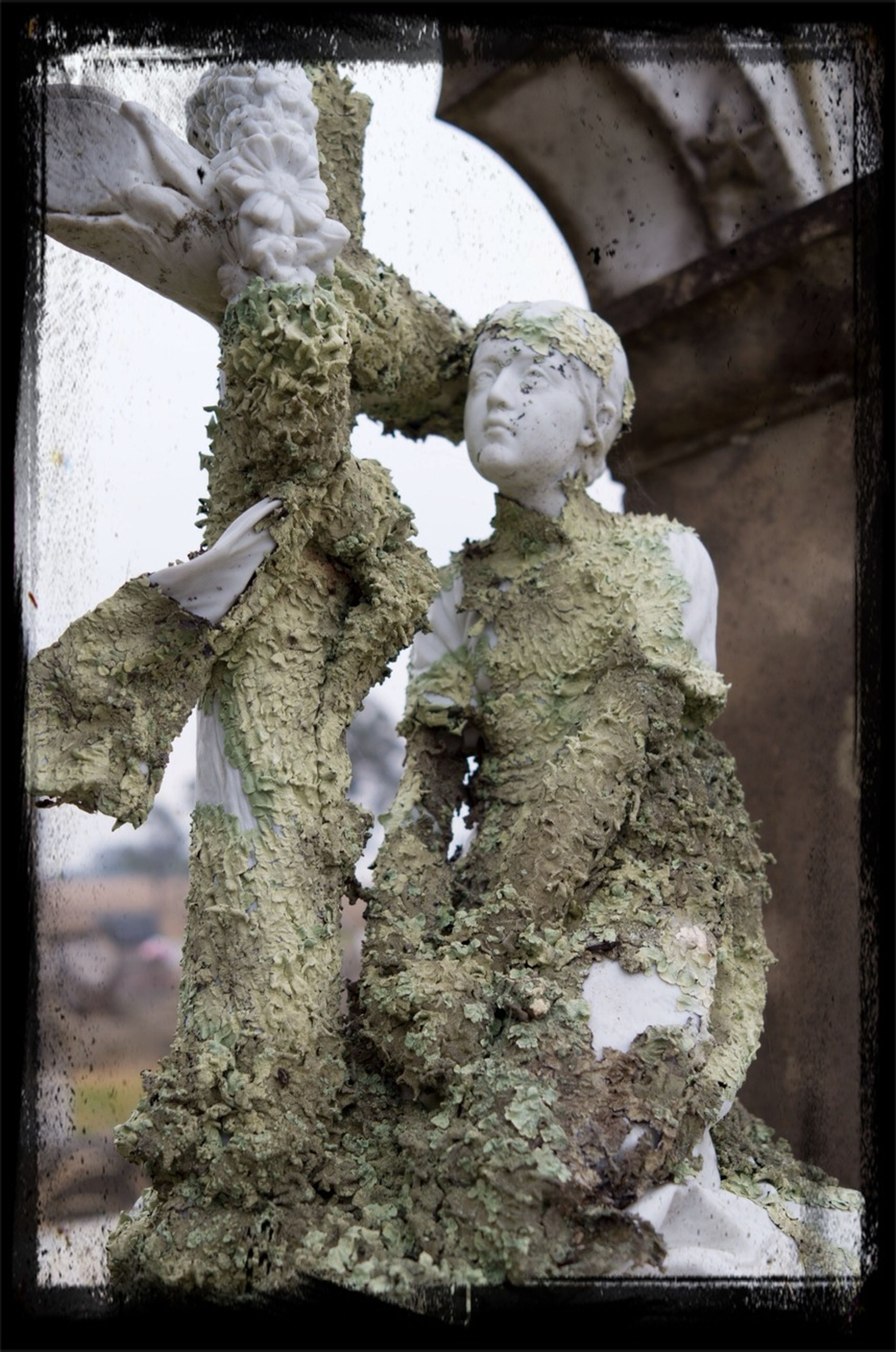 transfer print, auto post production filter, sculpture, human representation, statue, art and craft, close-up, low angle view, creativity, art, indoors, day, old, no people, carving - craft product, stone material, hanging