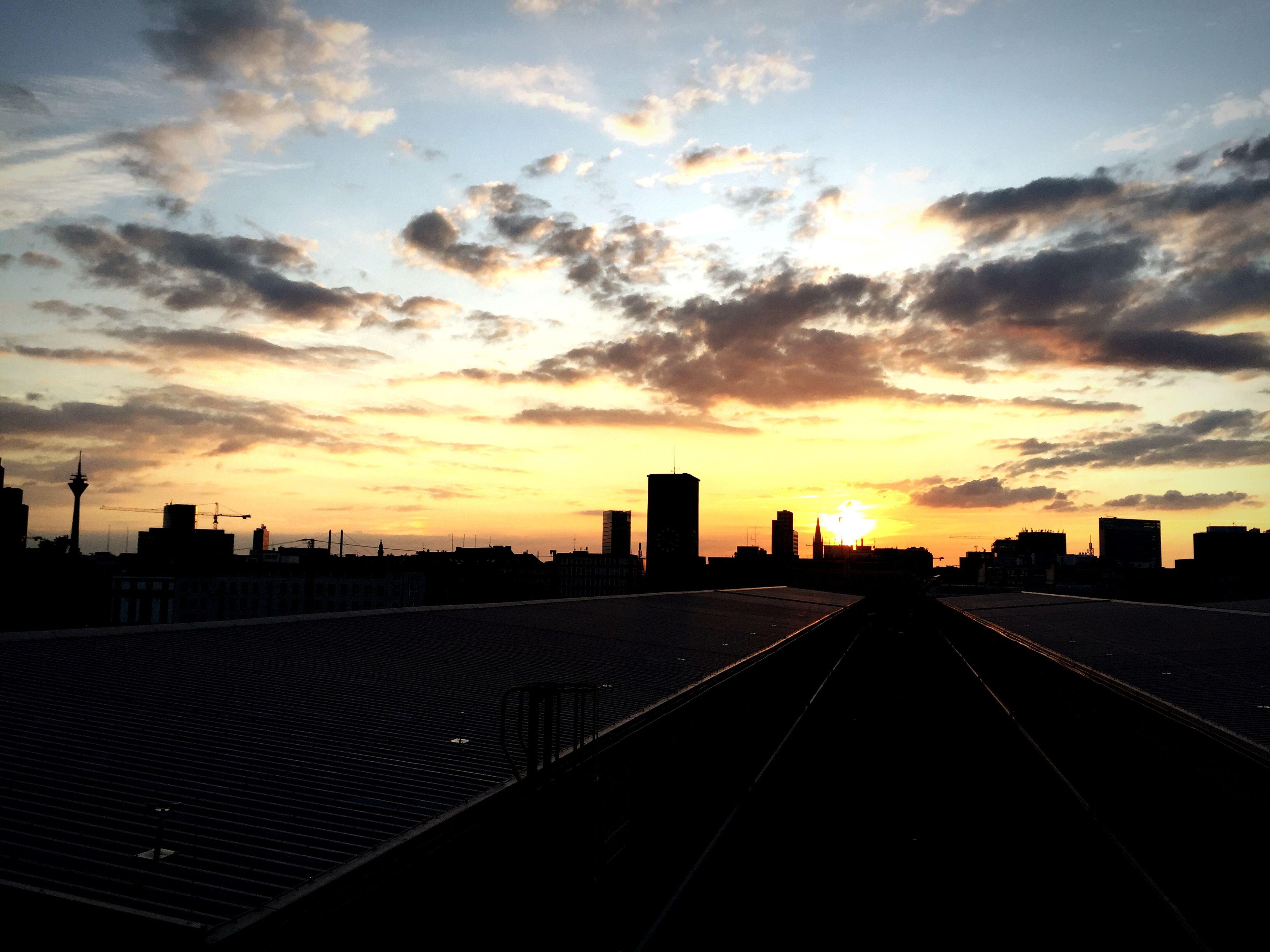 sunset, sky, silhouette, building exterior, cloud - sky, built structure, architecture, orange color, cloud, the way forward, cloudy, city, dramatic sky, scenics, dusk, diminishing perspective, outdoors, landscape, nature, sunlight
