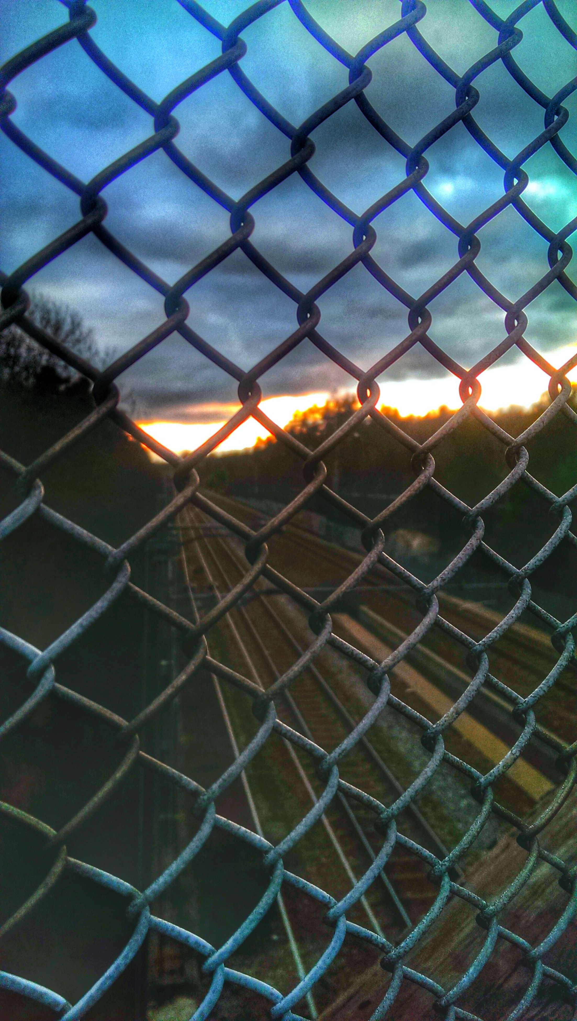 chainlink fence, full frame, fence, backgrounds, protection, safety, pattern, metal, security, metal grate, focus on foreground, no people, metallic, outdoors, close-up, city, day, transportation, water, design