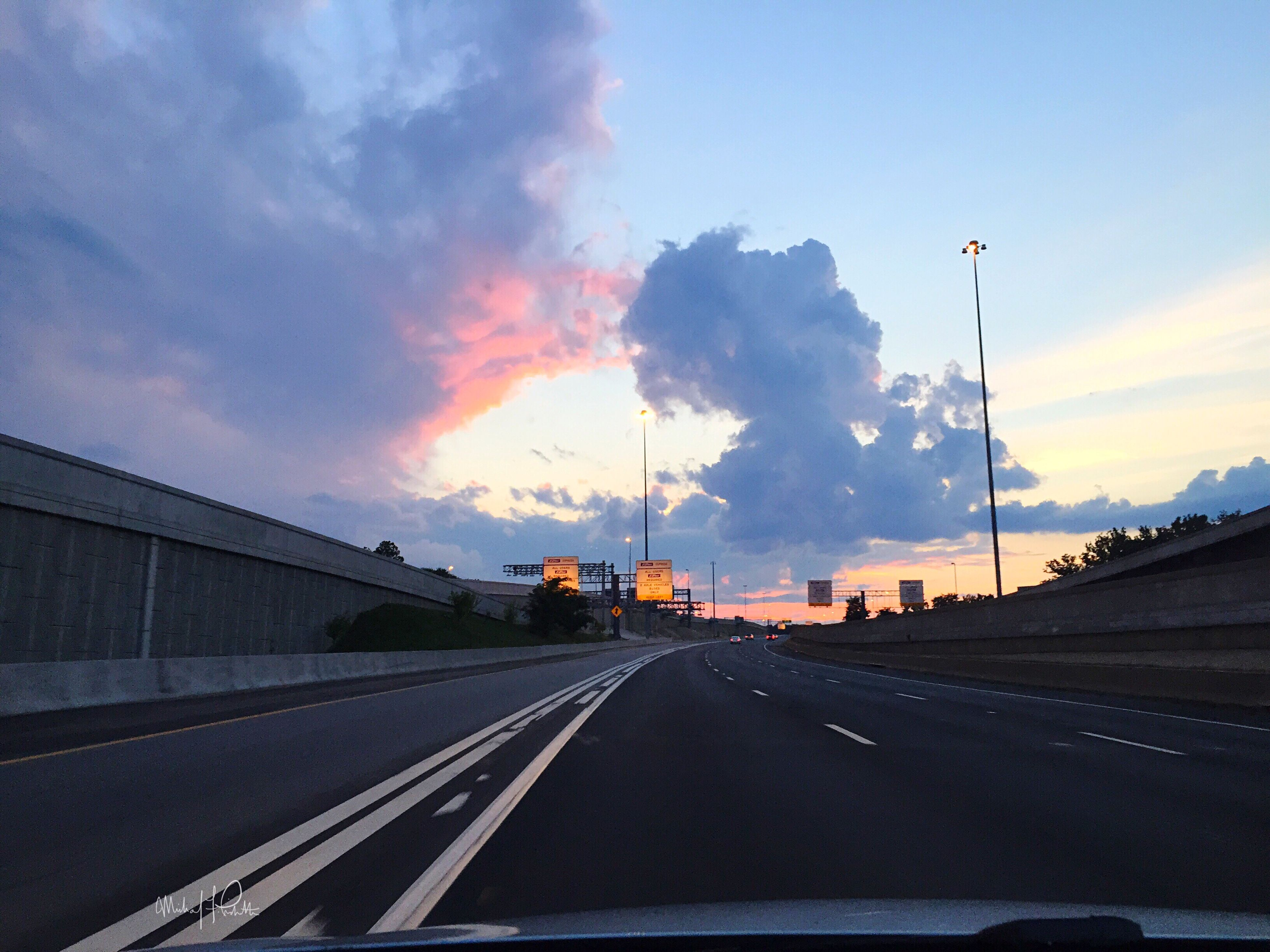 the way forward, sky, road, cloud - sky, diminishing perspective, sunset, road marking, vanishing point, cloud, cloudy, highway, outdoors, orange color, no people, dramatic sky, nature, empty, city, long, overcast, weather, blue