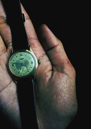Longines Human Body Part Human Hand One Person One Man Only Close-up Currency People Only Men Finance Coin Studio Shot Adult Black Background Adults Only Indoors  Day