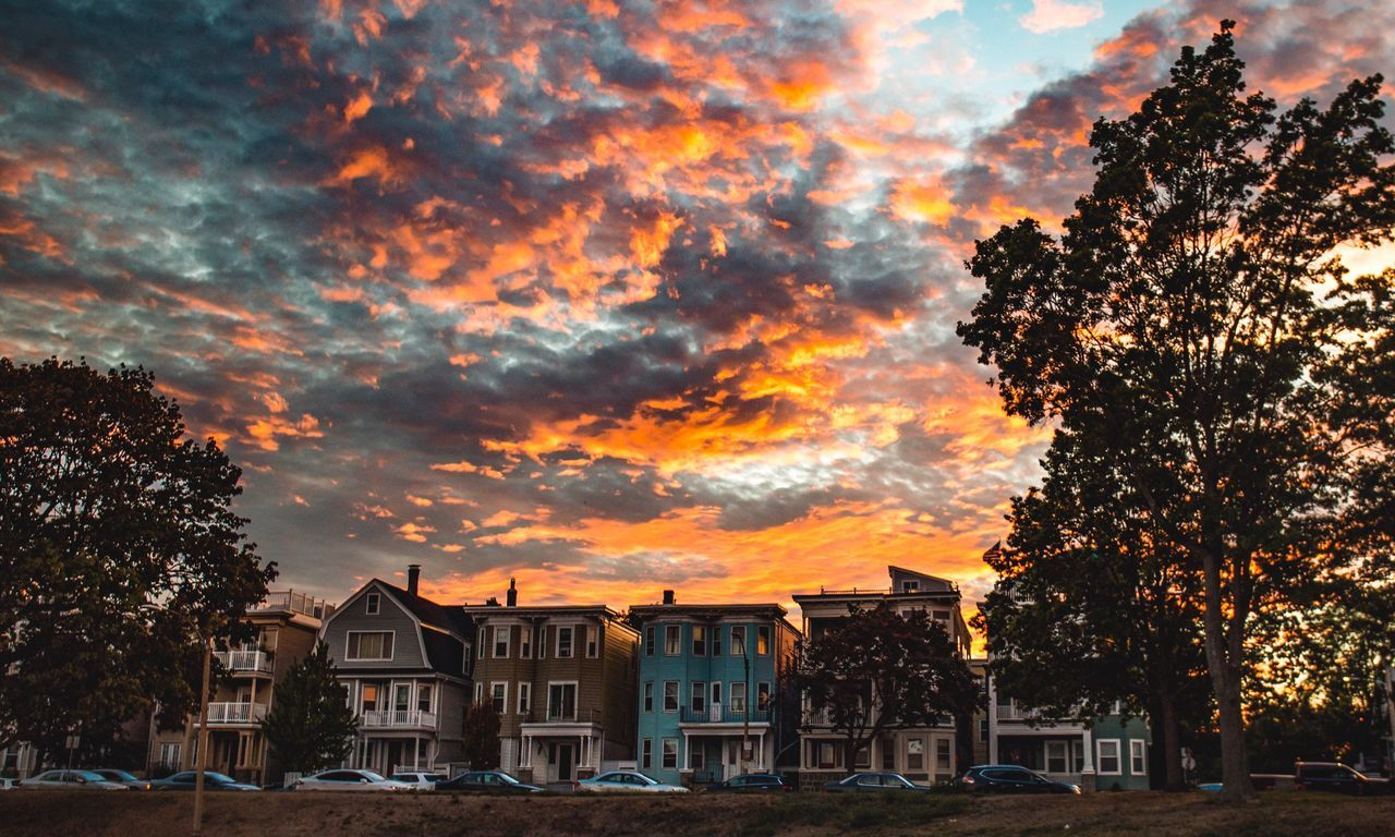 Scenic View Of Residential District Against Sky During Sunset