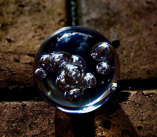 I love the reflection of the sky at the top of this Christmas bauble. Close-up Christmas Bauble Shiny Bubbles In Glass Reflection Sky Reflection Baubles Creative Creative Photography Christmas Decorations Lighting Cloud Reflections