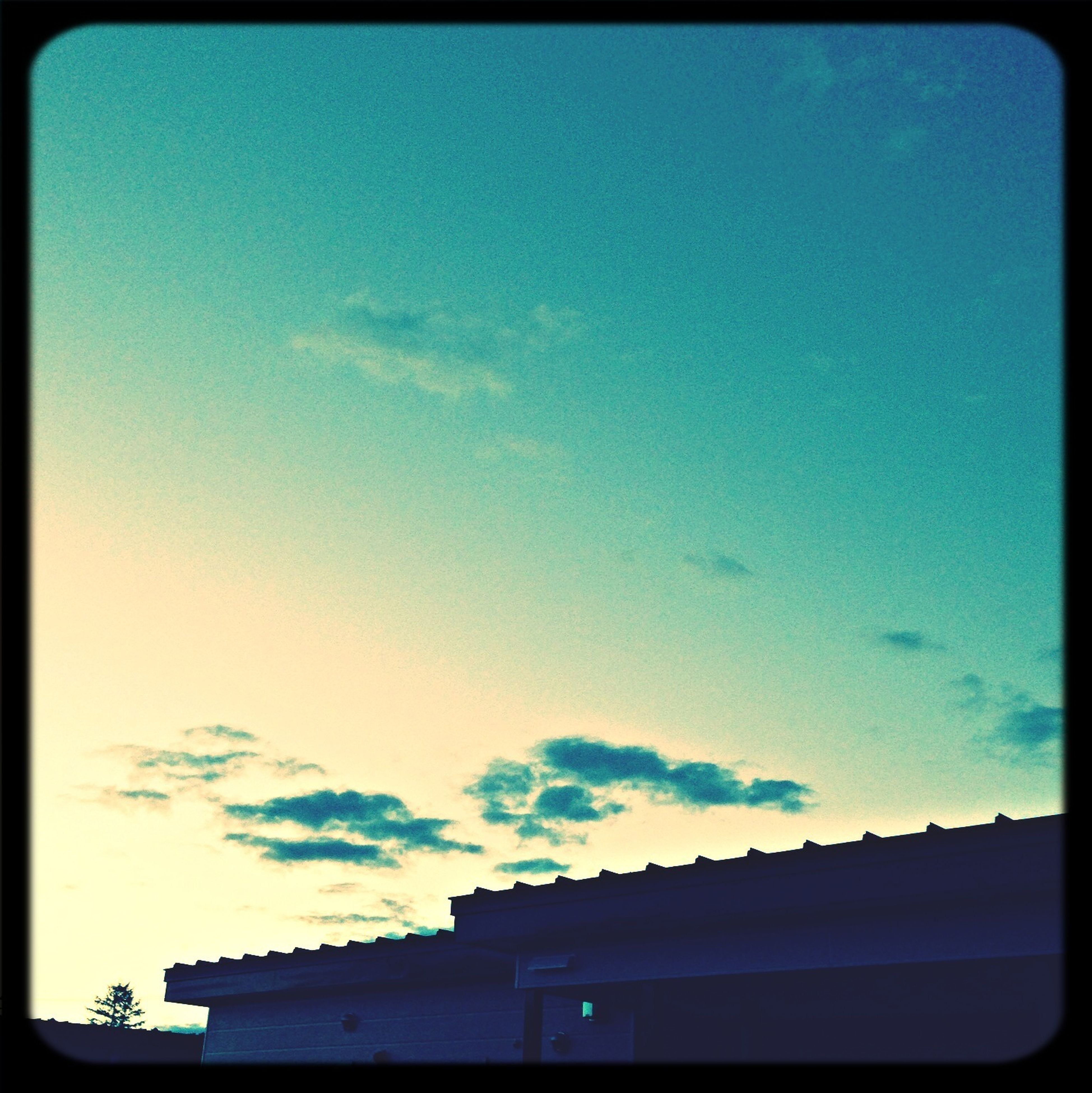 transfer print, sky, silhouette, auto post production filter, low angle view, blue, building exterior, built structure, architecture, copy space, sunset, dusk, cloud, cloud - sky, nature, transportation, outdoors, beauty in nature, no people, car