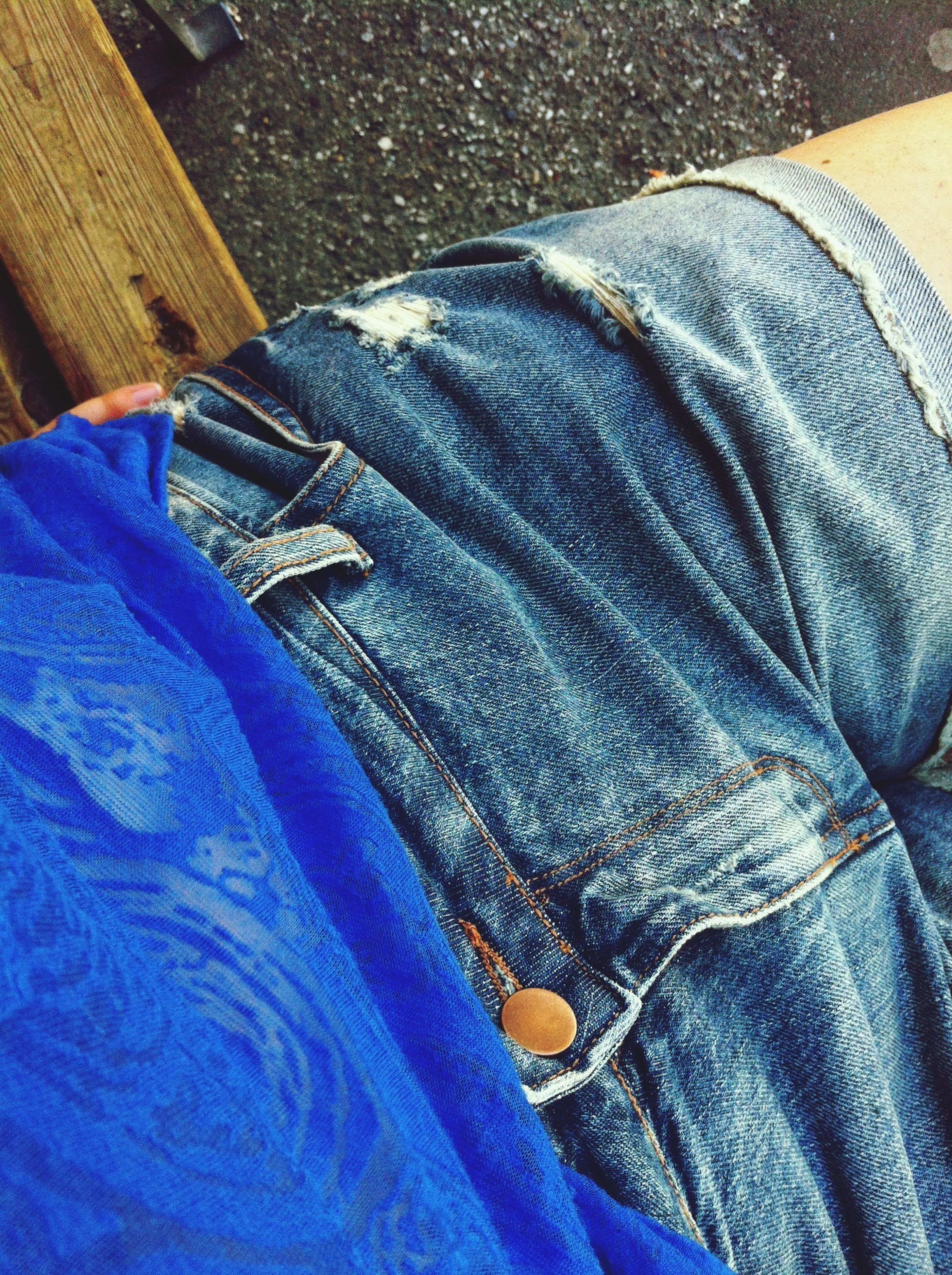 blue, low section, jeans, person, high angle view, wood - material, relaxation, shoe, day, outdoors, fabric, wooden, textile, close-up, personal perspective, men