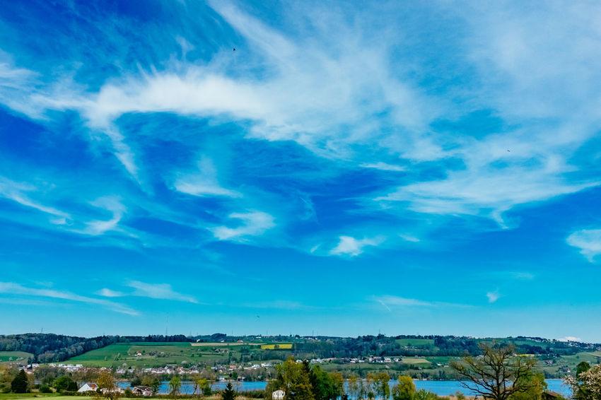 Atmospheric Mood Cloud Cloud - Sky Cloudscape Cloudy Community Distant Dramatic Sky Human Settlement Moody Sky Orange Color Outdoors Residential District Scenics Silhouette Sky Storm Cloud Sun Sunset Voyage