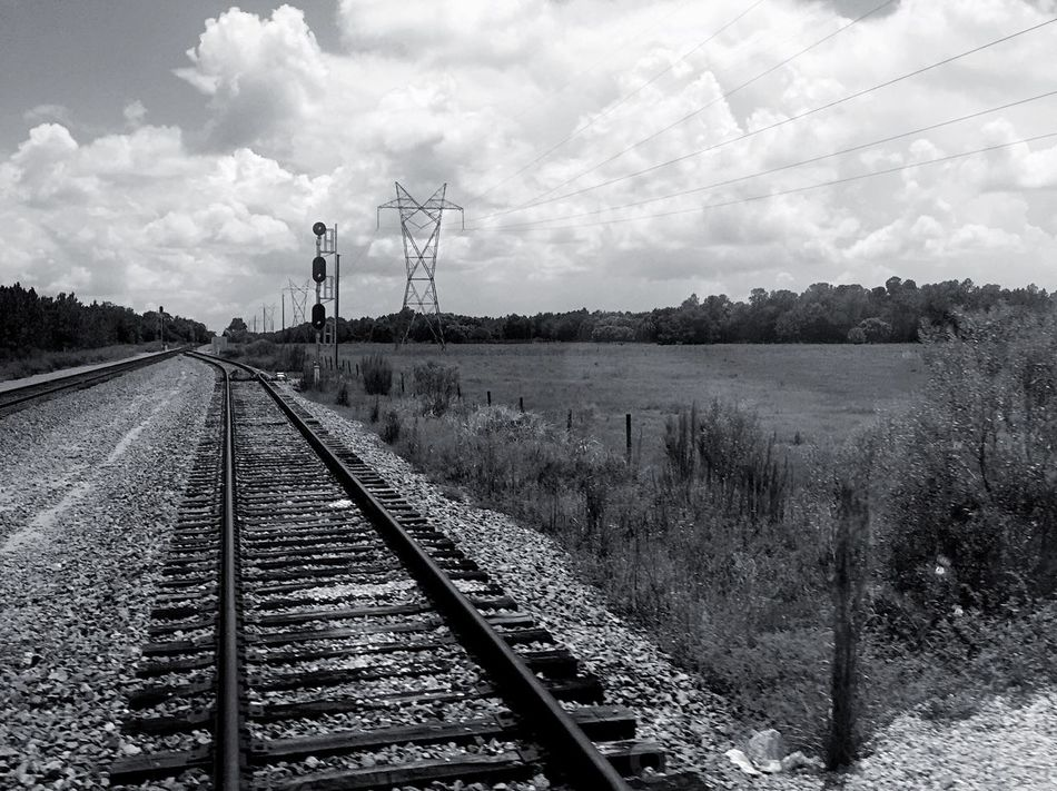 Old towns where the tracks still run through Diminishing Perspective The Way Forward Vanishing Point Fuel And Power Generation Sky Clouds And Sky Straight Tranquil Scene Cloud Tranquility Wind Turbine Environmental Conservation Day Outdoors Nature Narrow Cloudy Overcast Monochrome Black And White Railroad Track Landscape