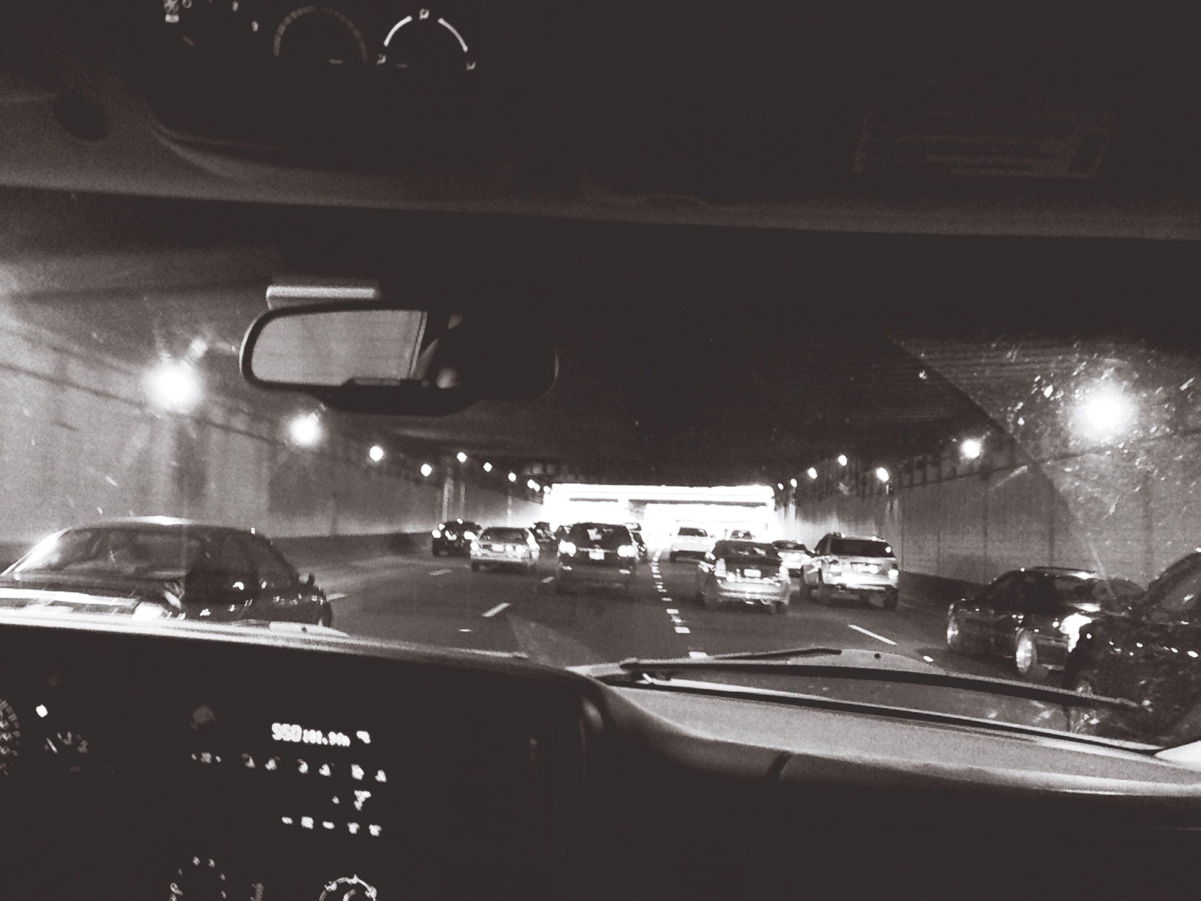 transportation, mode of transport, illuminated, land vehicle, car, night, indoors, vehicle interior, travel, lighting equipment, on the move, technology, incidental people, bus, public transportation, men, stationary, motion, traffic