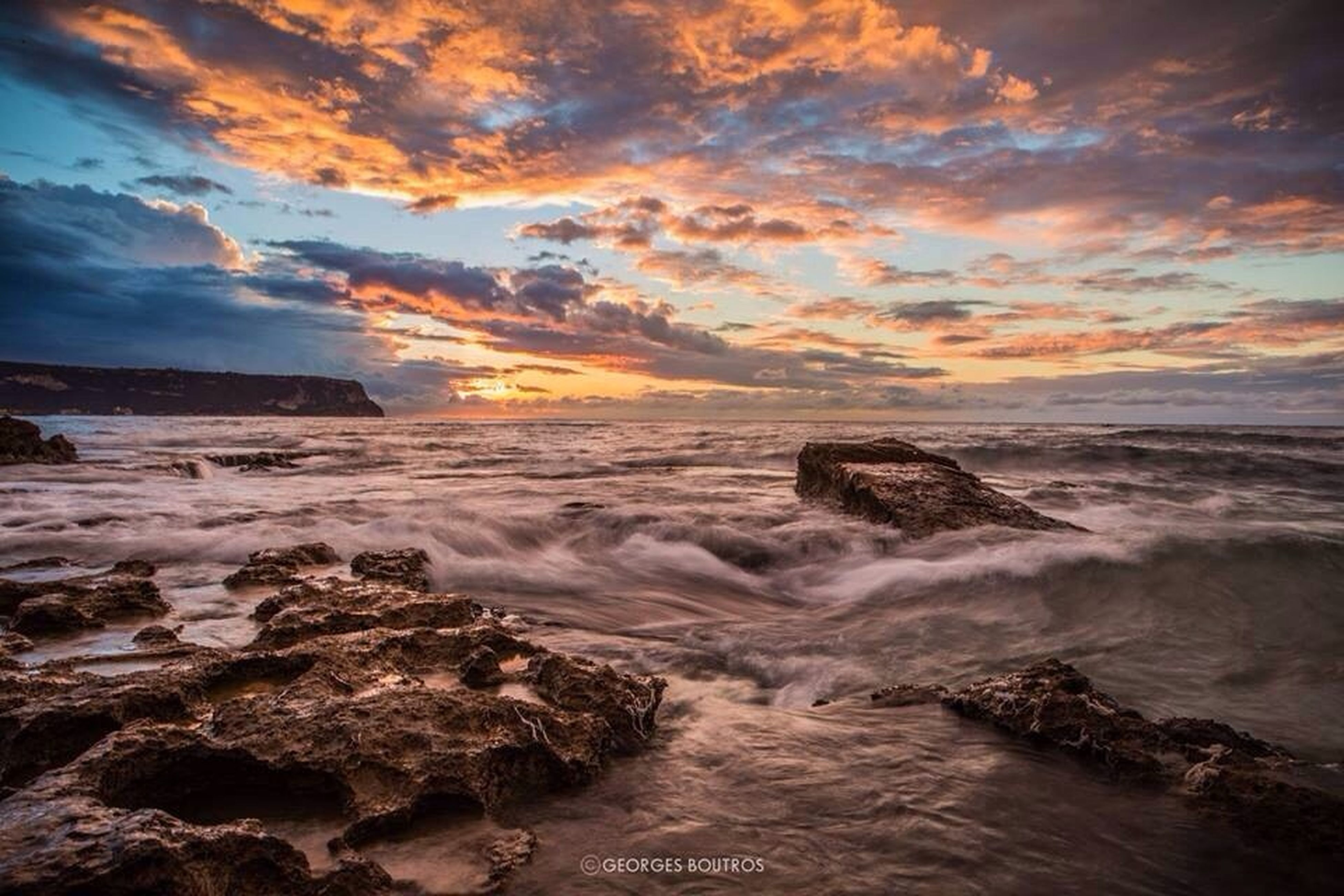 water, sea, sunset, sky, scenics, beauty in nature, tranquil scene, cloud - sky, horizon over water, rock - object, wave, nature, tranquility, idyllic, beach, surf, shore, dramatic sky, cloudy, rock formation