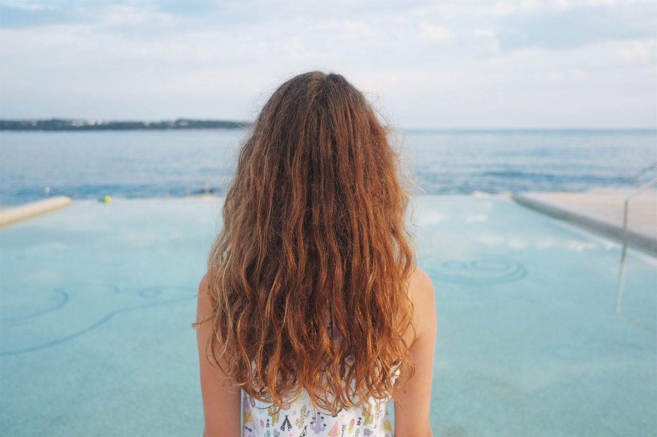 Never look back in anger. Water Sea Rear View Horizon Over Water One Person Human Hair Long Hair Real People Nature Tranquility Sky Leisure Activity Scenics Outdoors Day Standing Beauty In Nature Swimming Pool Close-up People Seaside