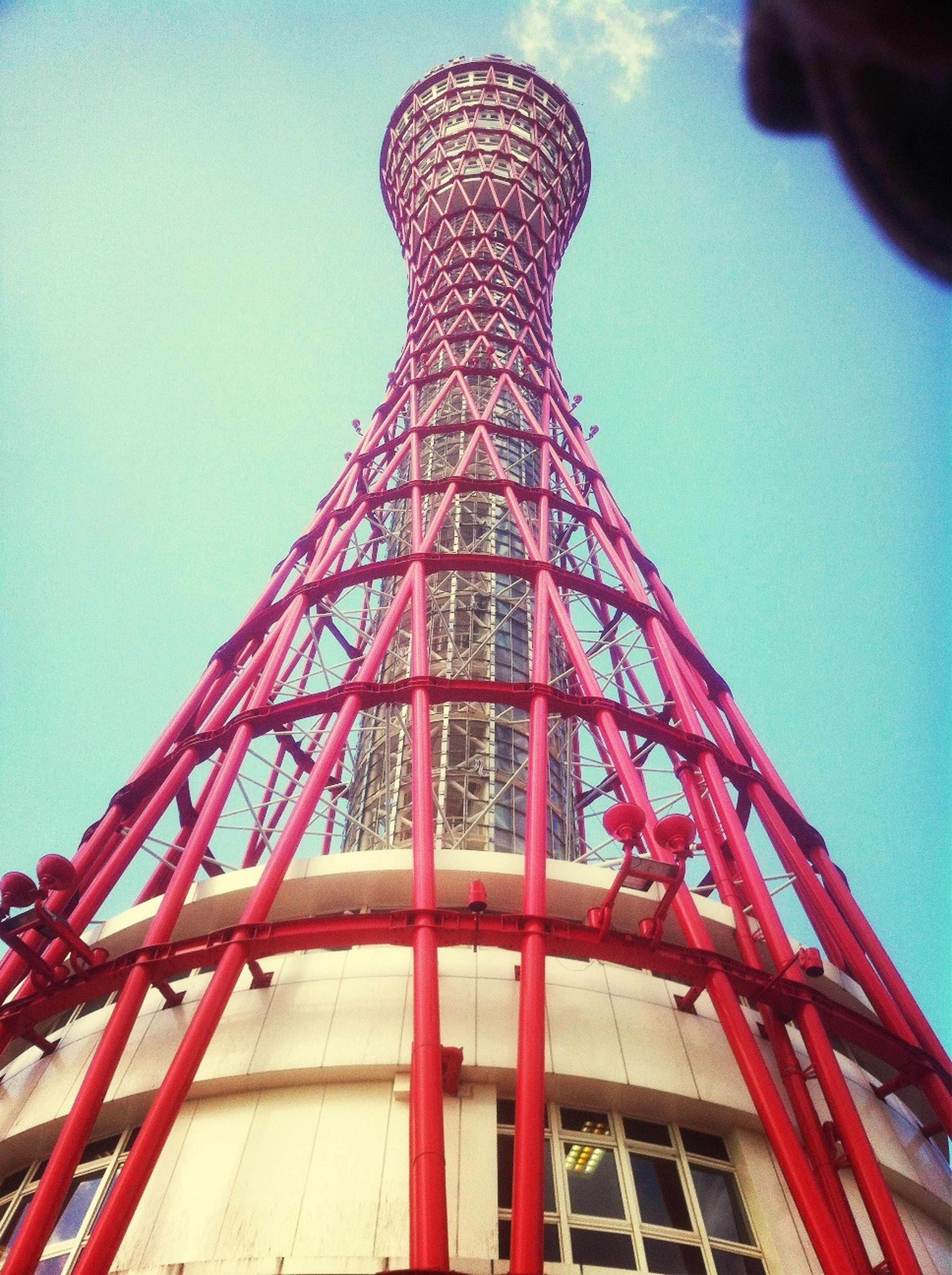 low angle view, architecture, built structure, red, building exterior, clear sky, tower, tall - high, famous place, blue, sky, international landmark, capital cities, metal, travel destinations, day, outdoors, no people, city, travel