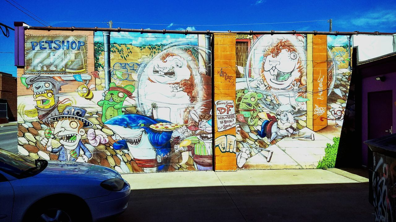 creativity, graffiti, human representation, no people, outdoors, built structure, day, land vehicle, architecture, building exterior, close-up