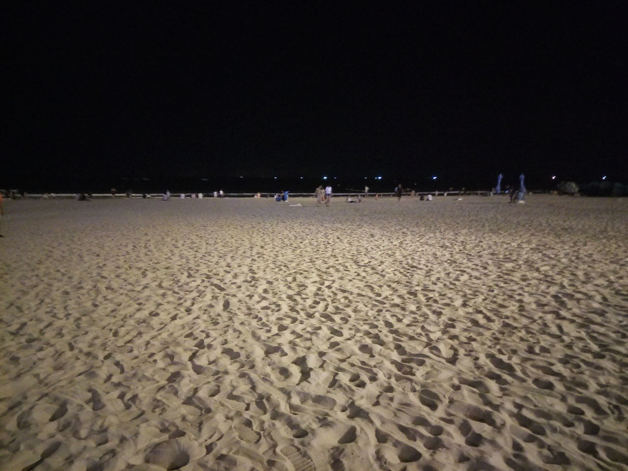 sand, beach, night, real people, nature, outdoors, leisure activity, large group of people, vacations, men, lifestyles, landscape, beauty in nature, sky, people